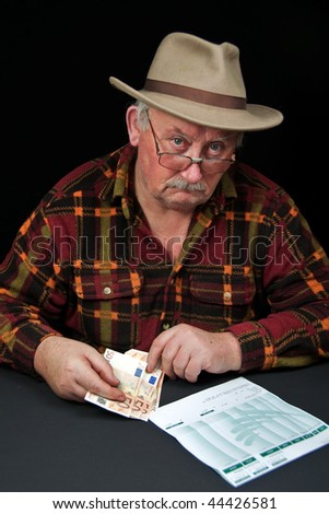 photo senior male with money issues on black background - stock photo