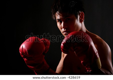 Photo Series of young asian boxer getting ready and stepping into the ring. - stock photo