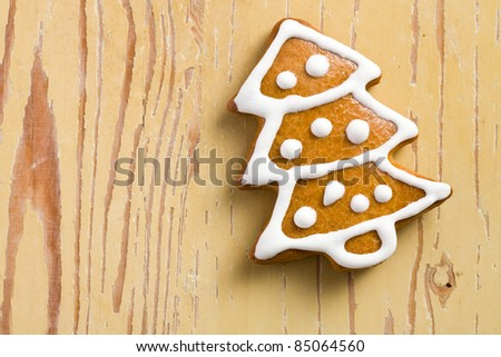 photo shot of christmas gingerbread on wooden background - stock photo