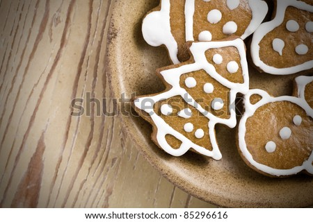 photo shot of christmas gingerbreads on wooden background