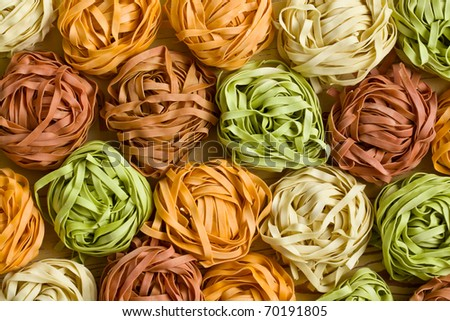 photo shot of colorful pasta tagliatelle - stock photo
