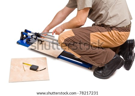 photo shot of man cut tiles - stock photo