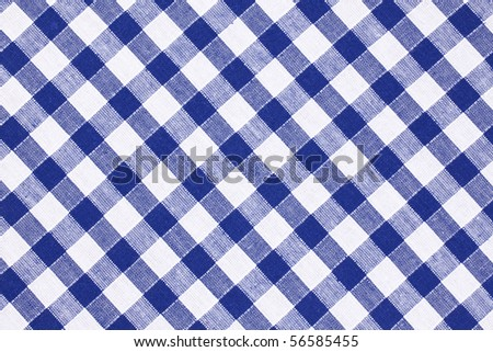photo shot of the blue checkered tablecloth - stock photo
