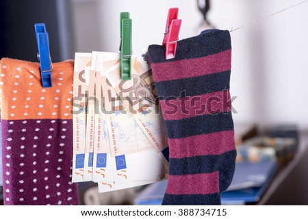 photo showing the savings in euros hidden in a sock
