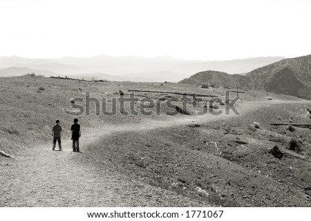 Photo showing two boys hiking at Windy Ridge, an area that was destroyed by the eruption of Mt. St. Helens. - stock photo