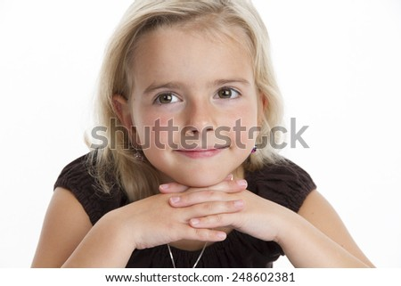 Photo shows a little girl, she is looking to camera. Studiolight white white background - stock photo