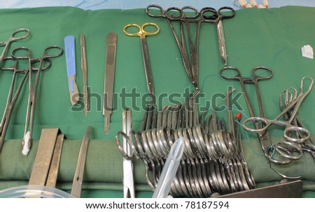 photo sterile table with surgical instruments - stock photo