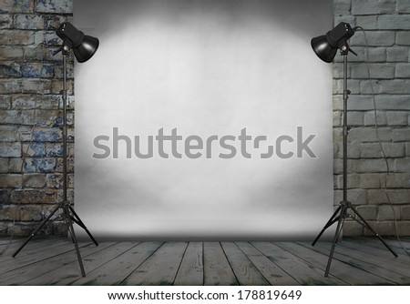 photo studio in old grunge room with brick wall and paper background  - stock photo