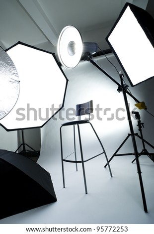 Photo studio setup with lighting equipment - stock photo