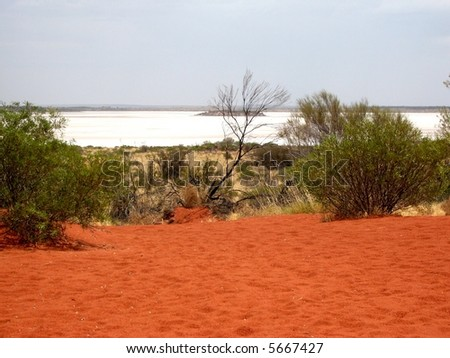 Photo taken of a salt lake from a sand dune in Australia's Northern Territory, off the Lasseter Highway. - stock photo