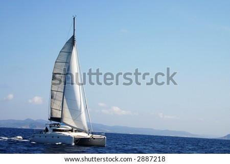 Photo took during the Route of the Salt (Ruta de la sal) between Denia and Ibiza competing against sailboats for a trophy. - stock photo