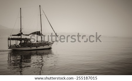 Photo tourist yachts set sail from Eilat. B and W. - stock photo