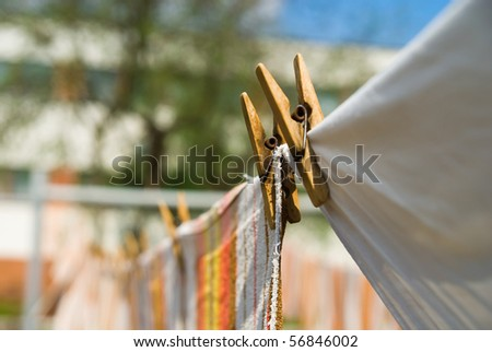 photo towels that hang on a rope in the street - stock photo