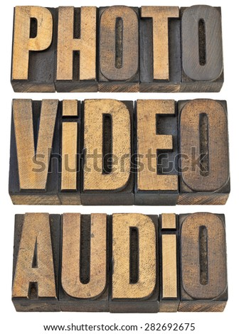 photo, video, audio words  - multimedia concept - a collage of isolated text in vintage letterpress wood type
