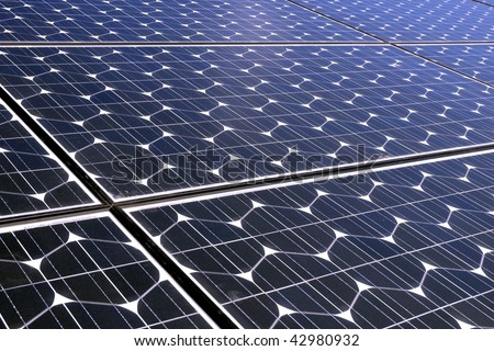 Photo-voltaic cells in a solar panel - perspective view - stock photo