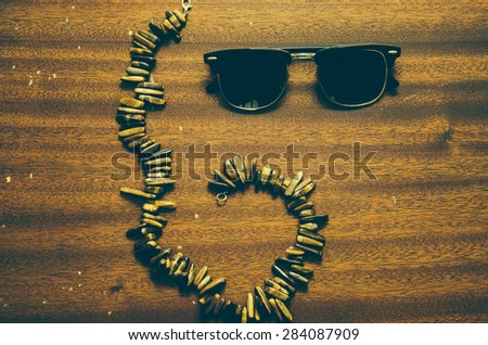 Photo with vintage filter of the sunglasses clubmaster and girl necklase - stock photo