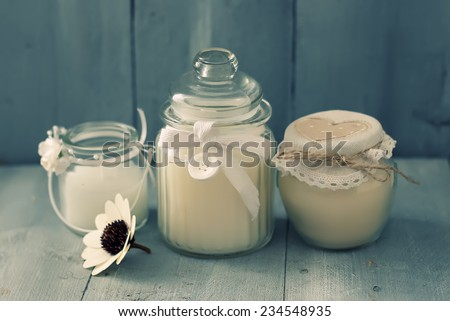 Photo with 3 white candles on wood - stock photo