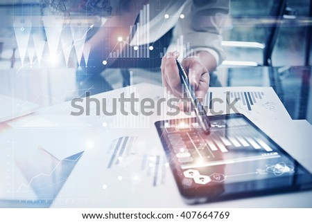 Photo working process. Finance director work new global project in worldwide bank office. Using modern tablet. Graphics icons, tax, stock exchanges interface. Horizontal - stock photo