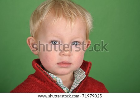 photo young male child portrait on green screen - stock photo