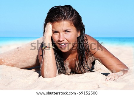 Photograph of a beautiful woman on the beach - stock photo
