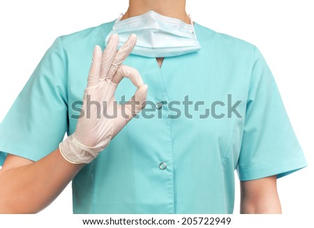 photograph of a bust of a woman surgeon making the sign all is well