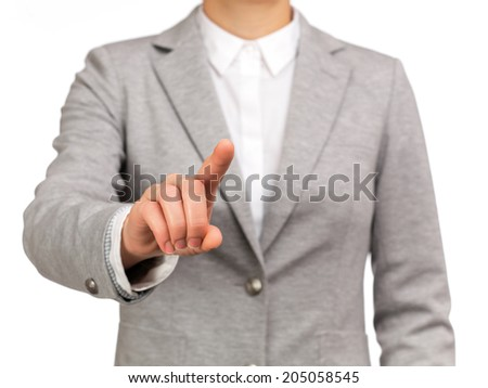 photograph of a bust of active woman pointing something with his finger - stock photo