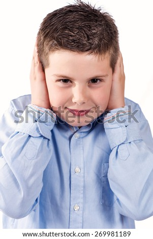 photograph of a child who will not listen on a white background - stock photo