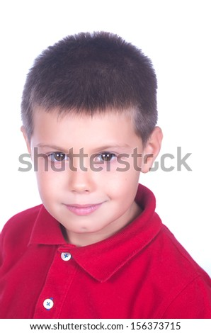 photograph of a child with red sweater posing on white background