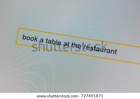 Photograph of a computer monitor where the person is looking where to book a table in the restaurant.