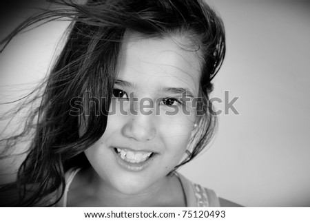 Photograph of a girl with her hair up in the wind in black and white - stock photo