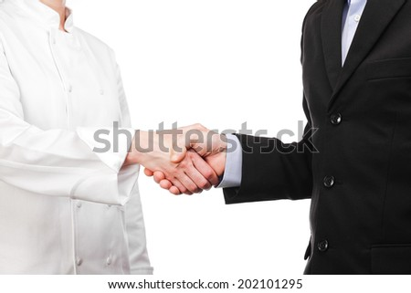 Photograph of a handshake between a cook and a businessman - stock photo