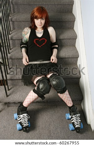 Photograph of a roller derby girl posing on the stairs of a stairwell. - stock photo