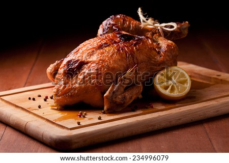 Photograph of a savory roasted chicken - stock photo