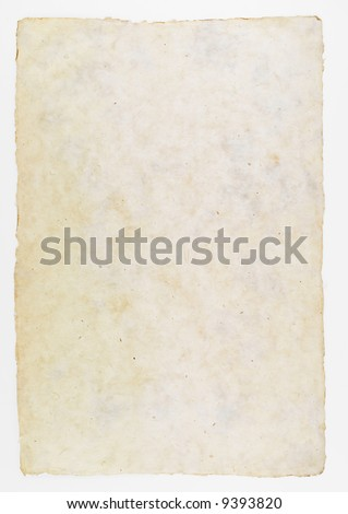 Photograph of a sheet of brown, cream colored paper.