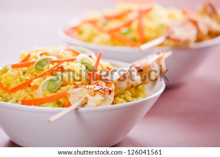 Photograph of a tasty bowl of chicken curry with rice