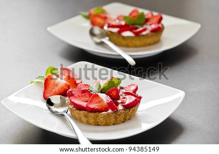 Photograph of a tasty strawberry pie on a plate