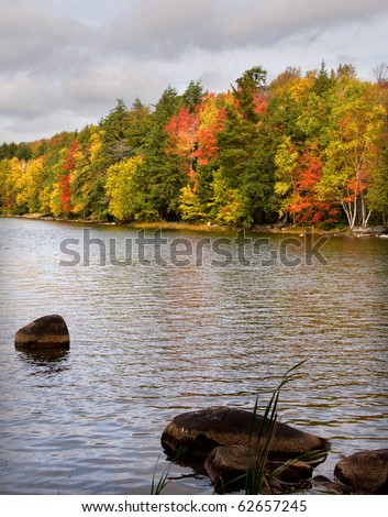 Photograph of a tranquil northwoods lake, taken during the beauty and solitude of the autumn season. - stock photo