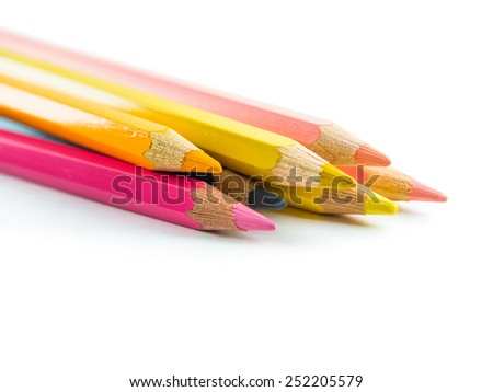 Photograph of an assortment of colored pencils seen from the side. - stock photo