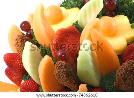 Photograph of an assortment of fresh fruit in a fruit basket, resembling a flower bouquet. - stock photo