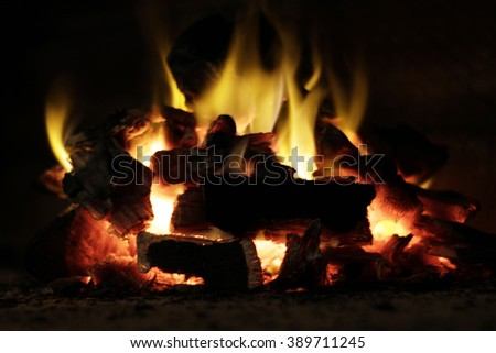 Photograph of charcoal pieces and fire flames