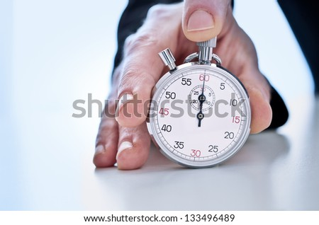 Photograph of Hand showing a stopwatch