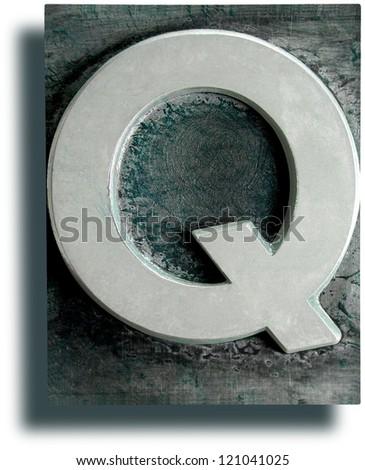 Photograph of Metal Letterpress Letter Q - stock photo