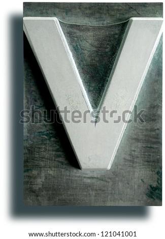 Photograph of Metal Letterpress Letter V - stock photo