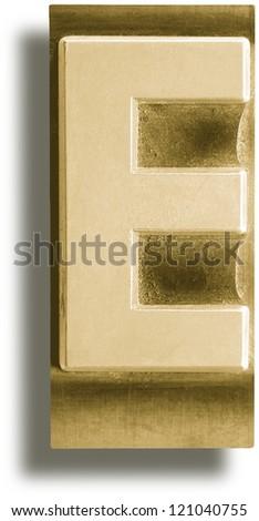 Photograph of Metal Letterpress Sepia Letter E - stock photo
