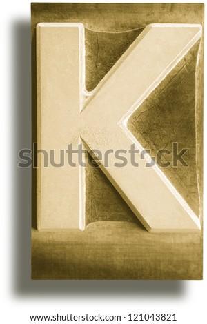 Photograph of Metal Letterpress Sepia Letter K - stock photo
