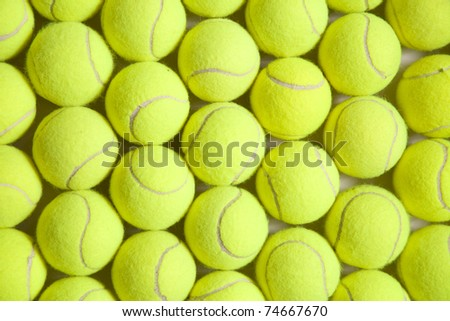 Photograph of numerous tennis balls from above. - stock photo