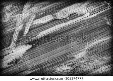 Photograph of obsolete old, weathered, varnished Wooden Laminated Panel, B&W, cracked, scratched, vignette grunge texture. - stock photo