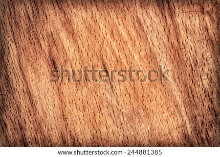 Photograph of old, roughly treated, warn out Beech Cutting Board vignette, grunge texture detail. - stock photo