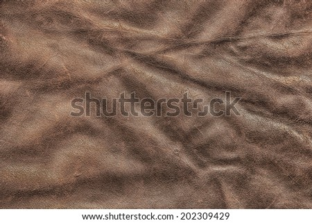 Photograph of old, weathered, rough, creased, coarse grained, crumpled, exfoliated cowhide texture sample - stock photo