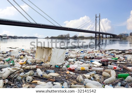 Photograph of polluted River full of rubbish showing environment we live in. - stock photo